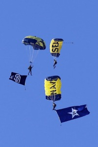 Navy SEAL Leapfrogs parachute over Petco Park with a flag in honor of former Padres announcer Jerry Coleman.